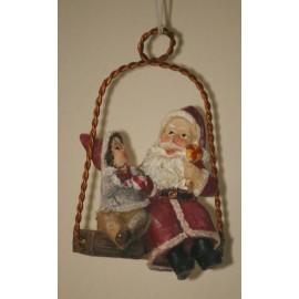 Decoratie santa op schommel met jongen 7 cm